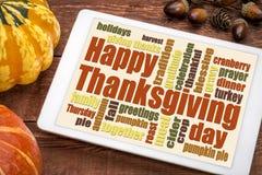 Nube feliz de la palabra de la acción de gracias en una tableta Fotos de archivo