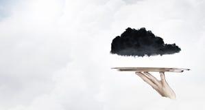 Nube negra en la bandeja imágenes de archivo libres de regalías