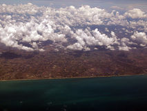 Nube, tierra y mar Fotografía de archivo