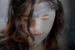 Nubes con la cara triste Imagen de archivo libre de regalías