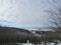 Nubes con los árboles y camino Fotos de archivo