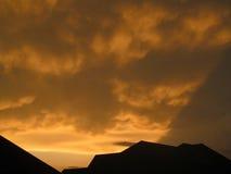Nubes de oro de Sun foto de archivo libre de regalías