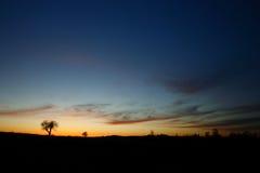 Nubes de Whispy en la puesta del sol Imagenes de archivo