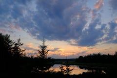 Nubes en la puesta del sol Imagenes de archivo