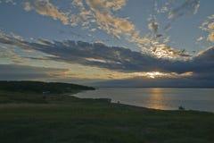 Nubes iluminadas por la puesta del sol Fotografía de archivo libre de regalías