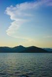 Nubes, monta?as, mar Foto de archivo libre de regalías