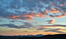 Nubes rosadas en la puesta del sol Imagen de archivo
