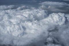 Nubes sobre Asia de un avión Fotos de archivo libres de regalías