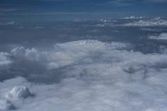 Nubes sobre Asia de un avión Foto de archivo