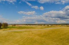 Nubes sobre campo del golf Imágenes de archivo libres de regalías