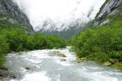 Nubes y río frío Fotografía de archivo libre de regalías