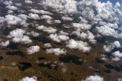 Nubi e le loro ombre Immagine Stock