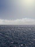 Nubi ed il mare. Fotografie Stock