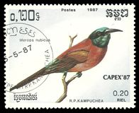 Nubian Bee eater, Merops nubicus. Cambodia - stamp printed 1987, Multicolor Memorable issue of offset printing, Topic Birds and Philatelic Exhibitions, Series Stock Photo