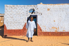 Nubian man wearing traditional clothing standing in front of the house Royalty Free Stock Image