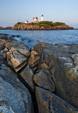 Nuble lighthouse, vertical. Nuble lighthouse at dusk located in York, Maine, USA stock image