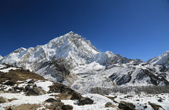 Nuche summit beside of everest from kallapather summit Stock Images