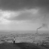 Nuclear. Mother and daughter are watching industrial landscape Stock Image