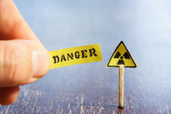 Nuclear danger warning. Background,  radiation hazard sign and danger tag Royalty Free Stock Photos