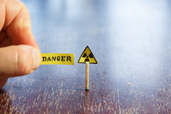 Nuclear danger warning. Background,  radiation hazard sign and danger tag Stock Photo