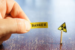Nuclear danger warning. Background,  radiation hazard sign and danger tag Stock Image