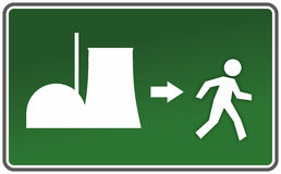 Nuclear. Emergency exit sign with figure and nuclear reactor Stock Photography