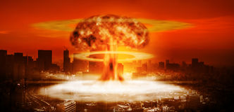 Nuclear explosion over a large city. And destruction and spread of the shock wave Stock Photos