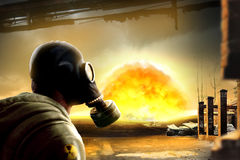 Nuclear explosion postapocaliptic scene with you man in gas mask Stock Photo