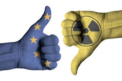 Nuclear icon on male thumb up and down  hand. Nuclear icon  on male thumb up and down  hand Royalty Free Stock Images
