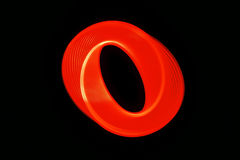 Nuclear loop. Symmetrical spiral shape created by moving red glowing light Stock Photos