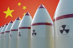 Nuclear missiles and Chinese flag in background. 3D rendered illustration Stock Images