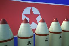 Nuclear missiles and North Korea flag in background. 3D rendered illustration Royalty Free Stock Images
