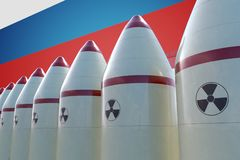 Nuclear missiles and Russian flag in background. 3D rendered illustration Stock Images