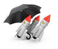 Nuclear missiles under umbrella Royalty Free Stock Image