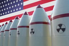 Nuclear missiles and USA flag in background. 3D rendered illustration Stock Image