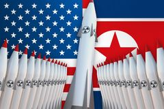 Nuclear missiles of USA and North Korea in a row and their flags Royalty Free Stock Photography