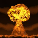 Nuclear mushroom. Rising over land Royalty Free Stock Photography