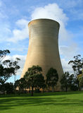 Nuclear plant cooling tower. With steam rising from top, beautiful sunny day Stock Images