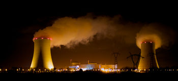 Nuclear plant at night. A massive nuclear power plant at night Royalty Free Stock Photography