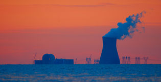 Nuclear Plant Red. A nuclear plant on the Delaware River at a very red sunset Stock Photo