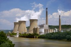 Nuclear Plant on the River. A nuclear power plant situated along side a river