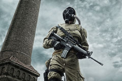 Nuclear post apocalypse survivor. Post apocalypse. Sole survivor in tatters and gas mask on the ruins of the destroyed city Stock Image