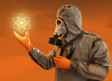 Nuclear Power. Man In Protective Costume With The Shining Nuclear Power Symbol stock image
