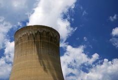 Nuclear Power. A nuclear cooling tower with beautiful blue sky Royalty Free Stock Photography