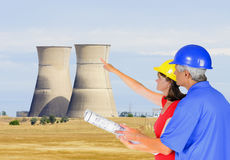 Nuclear power engineers. Engineers studying planning of nuclear power station decommission Stock Photos