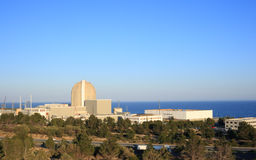 Nuclear power plant. By the sea in Vandellos (Tarragona, Spain), warm afternoon light Royalty Free Stock Photography