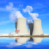 Nuclear power plant. Nuclear power plant over lake Royalty Free Stock Photo