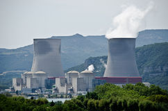 Nuclear power plant. Nuclear plant generating electricity. Two towers among hills Royalty Free Stock Photography