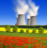 Nuclear power plant. In spring landscape Stock Photos
