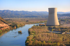 Nuclear power plant. Asco nuclear power plant over the Ebro river (Tarragona, Spain), warm afternoon light Royalty Free Stock Photography